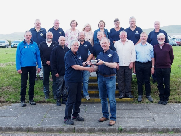 Diana Baines receives the Jim Clark Marshalling Award from Garry Headridge during the Mach1 Stages at Machrihanish in July 2019